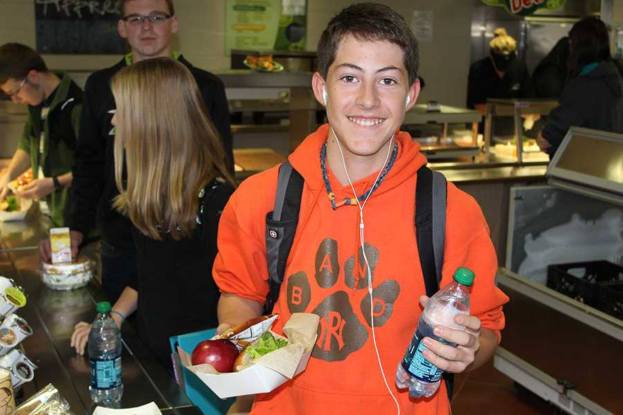 Ben Friedman (9) grabs a healthy Michelle Obama supported lunch.