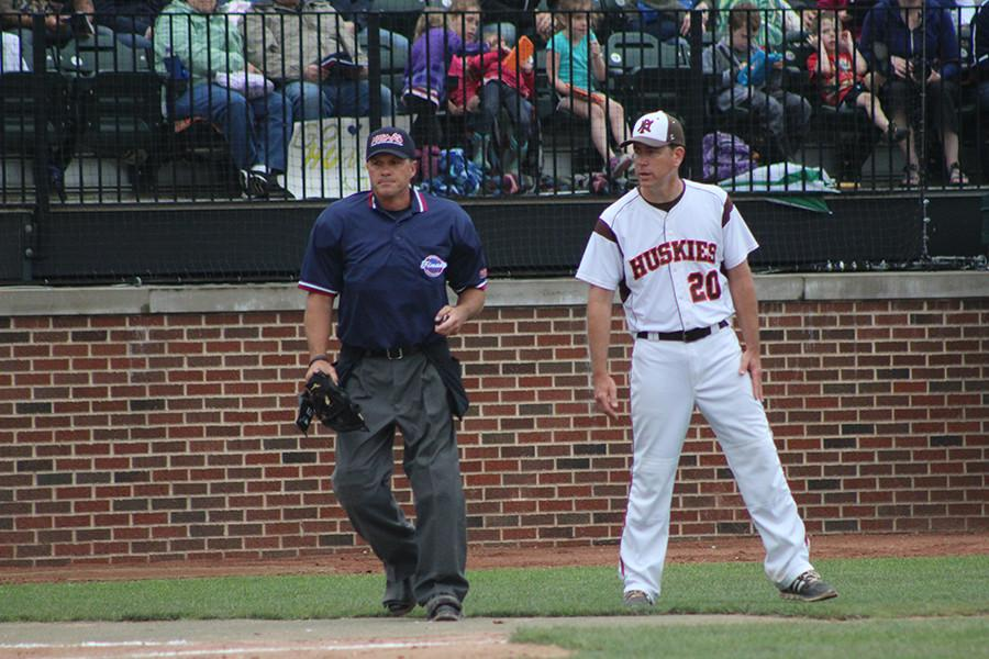 Coach Andrews asking umpire what he saw.