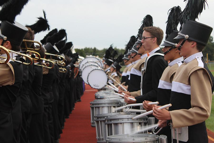 The drummers play the National Anthem.
