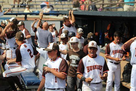 Huskies celebrate after scoring run.