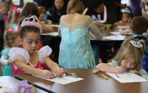 Tiny princesses color pictures at last year's princess tea party.