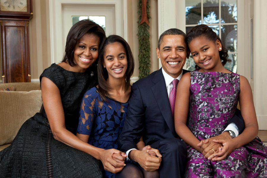 President Barack Obama, First Lady Michelle Obama, and daughters Sasha and Malia, pose for portrait photos in the Oval Office,  Dec. 11, 2001.  (Official White House Photo by Pete Souza)
