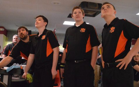 The bowling team keeps an eye on the scoreboard at the state tournament. They finished in 11th place.