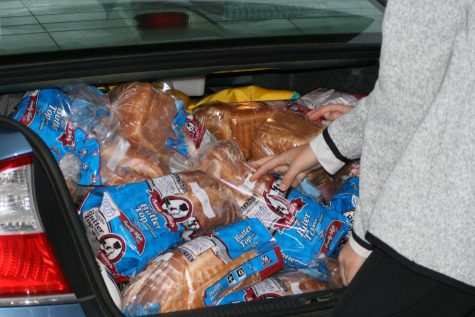 Bread is stuffed into the truck so students can start lifting as much as possible.