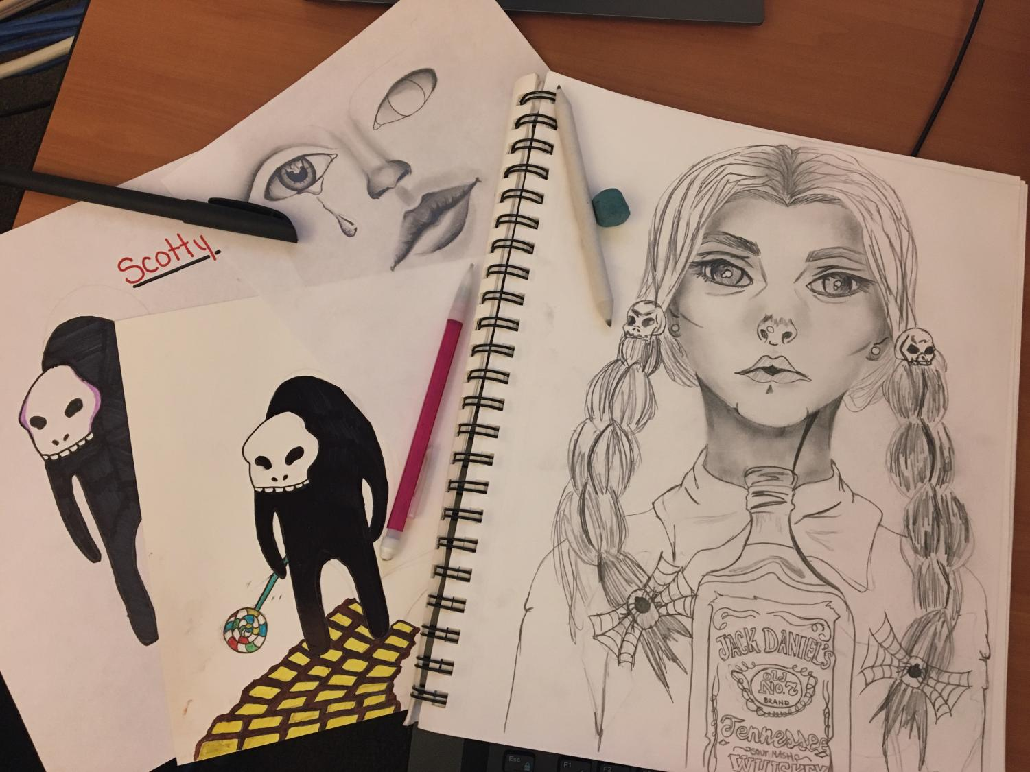 """Pictured here are some of Hailee's artwork. """"I mostly like to draw realistic things, especially people,"""" she said. She was also chosen to draw the illustration for the staff editorial in the first print edition of the Northern Light. Photo by Hailee Clark."""