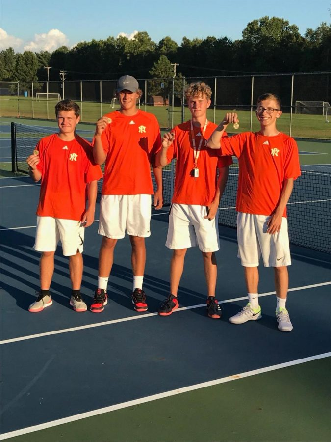 Alex+Wootton%2C+Jackson+Graham%2C+Graham+Holley+and+Keegan+Bach+celebrate+with+their+medals+after+winning+their+flights+at+the+Greater+Kalamazoo+tournament.+This+was+the+first+time+in+history+that+Northern+swept+singles.