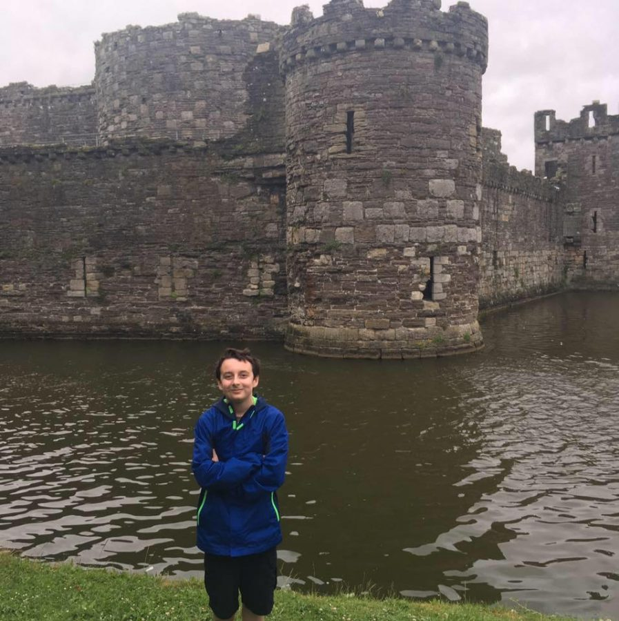 Stevens stands next to the 12th century Beaumaris Castle while on vacation in Holyhead, Wales. The castle was built during the reign of Edward I.