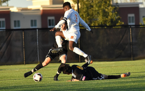 Junior midfielder Levi Crooks leaps over a PC defender in the first round of the league tournament. The Huskies lost 1-0, despite controlling play for most of the game. The Mustangs went on to win the tournament, and PN came in third. Photo courtesy of Portage Central parent photographers.