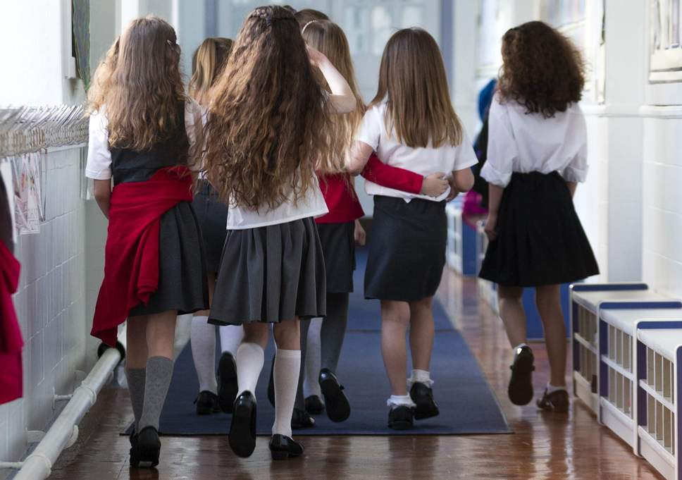 School uniforms would erase the need for a dress code and help all students focus more.