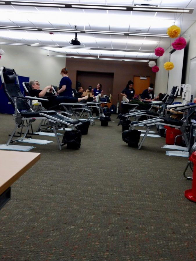 The first four people getting their blood drawn on the morning of blood drive.