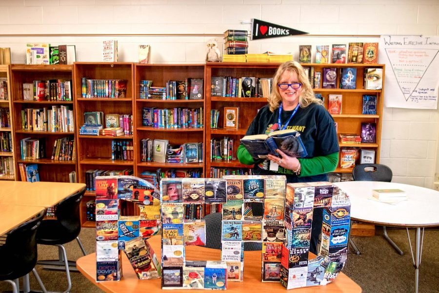 English teacher Sarah Miller at home in her classroom, which is full of books.