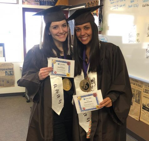 Isabel Reid (at left) and Hannah Thomas Perez (at right) pose with their mock-diplomas. Photo courtesy of Hannah Thomas Perez.