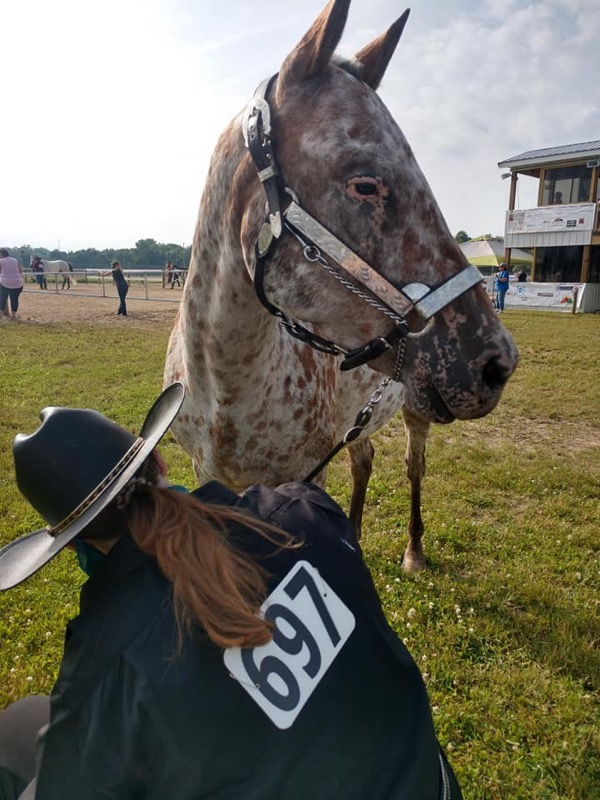 Funk at a horse show before the pandemic and her lung surgery. She has been riding for 11 years.