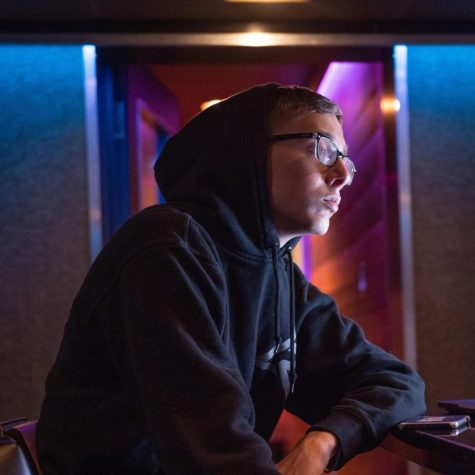 "KBeaZy is pictured in his natural environment for his Genius profile. It reads, ""KBeaZy, born Keegan Bach, is a 19 year old producer from Kalamazoo, Michigan. He quickly rose to fame in 2019 after various creating beats for established artists. His eponymous YouTube channel has racked up over 120,000 subscribers and over 12 million views.""  If the name Keegan Bach doesn't sound familiar, there's a chance you just don't know who he is. There's also a chance that you know him by the same name that most of the world does: KBeaZy. Graduating from Portage Northern High School in 2019, KBeaZy now lives in California and he just went #1 on the Billboard charts with his newest production: Mood by 24kGoldn ft. iann dior. If you didn't know him before, you would do well to get familiar.  Just two years ago, Bach was a student at Portage Northern High School. He played tennis and took IB classes. But if you ask his family, they knew he was going to make it big in music. ""His main focus throughout highschool was education until his music business really picked up. I think we all knew that if he did decide to fully pursue music he would be successful,"" shares his brother, PNHS freshman Kirby Bach. ""One cool thing that sticks out in my mind was when he first flew out to LA alone to make music for a week. That was when I personally realized that he was going to make it.""  KBeaZy may have started small, but you would never know it by looking at the work he's done. Genius.com shows him with production credits with artists like iann dior, 24kGoldn, Chief Keef, Baby Keem, The Kid LAROI, and Roddy Ricch. He is even credited with the production of unreleased tracks with Juice WRLD, who died in 2019 before much of his music was released. KBeaZy worked with artists like Baby Keem and Roddy Ricch before"