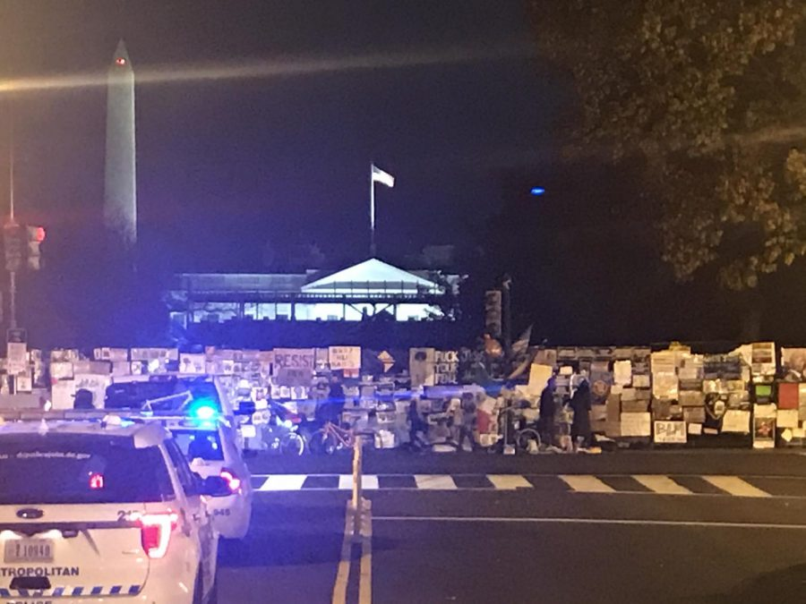 The White House is visible here illuminated beyond the Black Lives Matter signs.