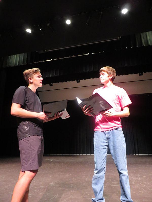 Jack Lancaster (12) and Drew Dixon (11) rehearsing lines for Chicago.