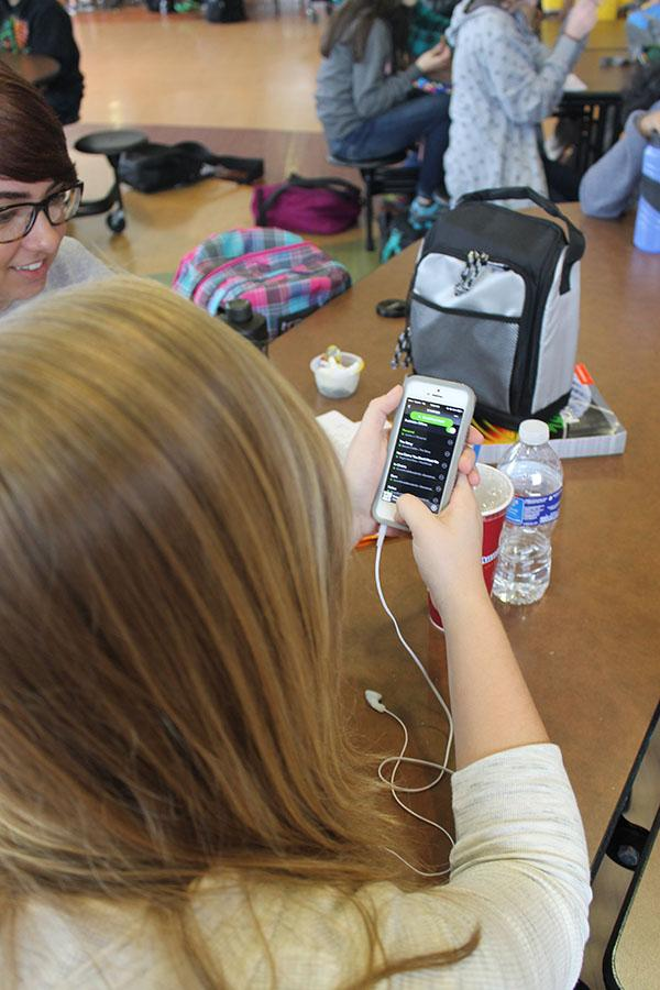 Mara Hazen (12) looks over her playlist.