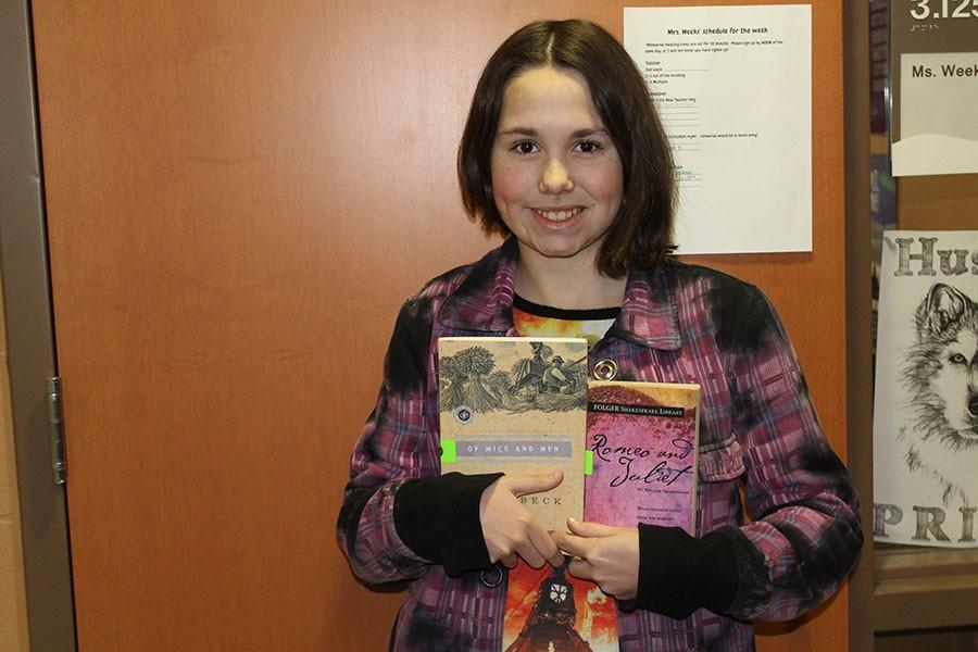 Smiling from ear to ear, freshman Charlotte Zimmer holds up two of PN's required reads. Take a look at which books are the most popular.