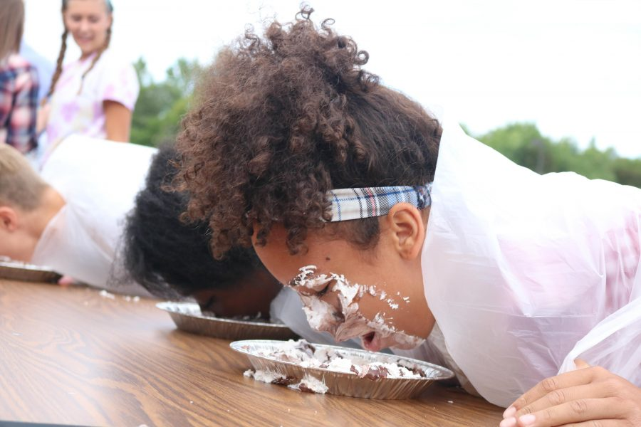 Sanai Gibson (10) tries to lead her class to victory in the Homecoming pie eating contest.