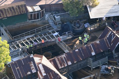 Investigators examine the wreckage at Dreamworld after the accident.