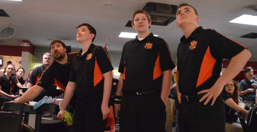 The+bowling+team+keeps+an+eye+on+the+scoreboard+at+the+state+tournament.+They+finished+in+11th+place.+