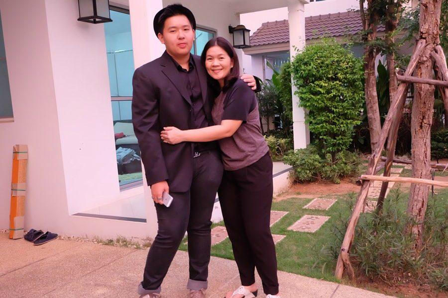 Poom Atiwetin finds new family at NHS while cherishing his birth family in Thailand