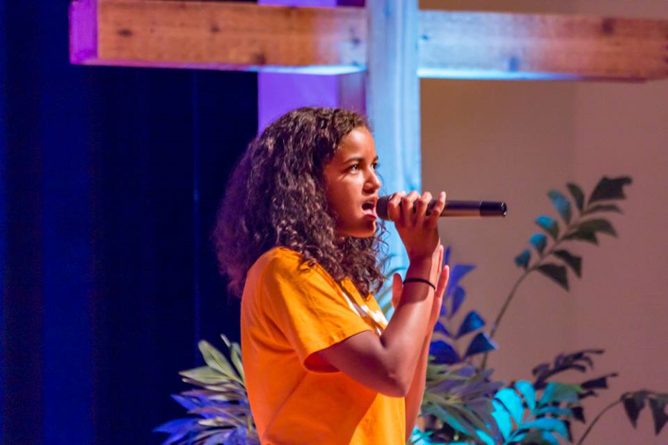 Madison performs as one of the singers in her worship team at church.