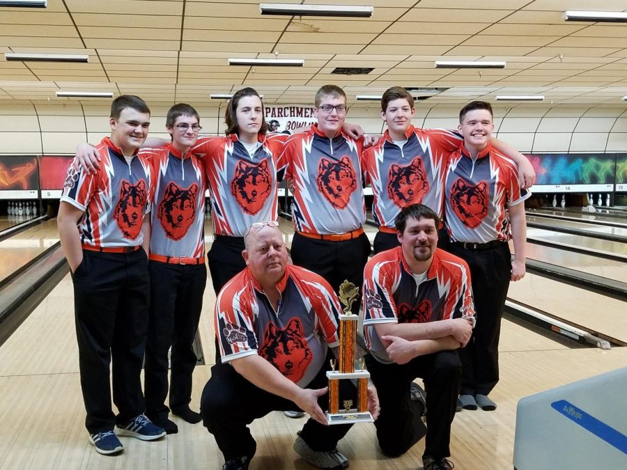 The team celebrates after their win. Left to right are Max Mayer, Brandon Paddock, Collin Empie, Adam Rowlson, Nate Curl, and Cris Smith. In front are coaches Richard Teusaw and Bill Tomlinson. Photo courtesy of Michael Schneider.