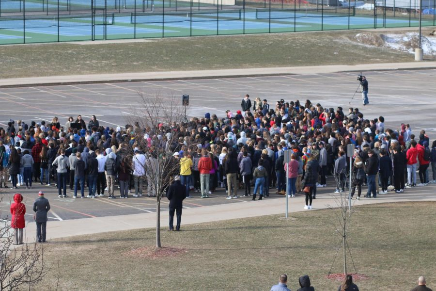 Many students braved the cold to participate in National Walkout Day. Photo by Amanda Thorpe.
