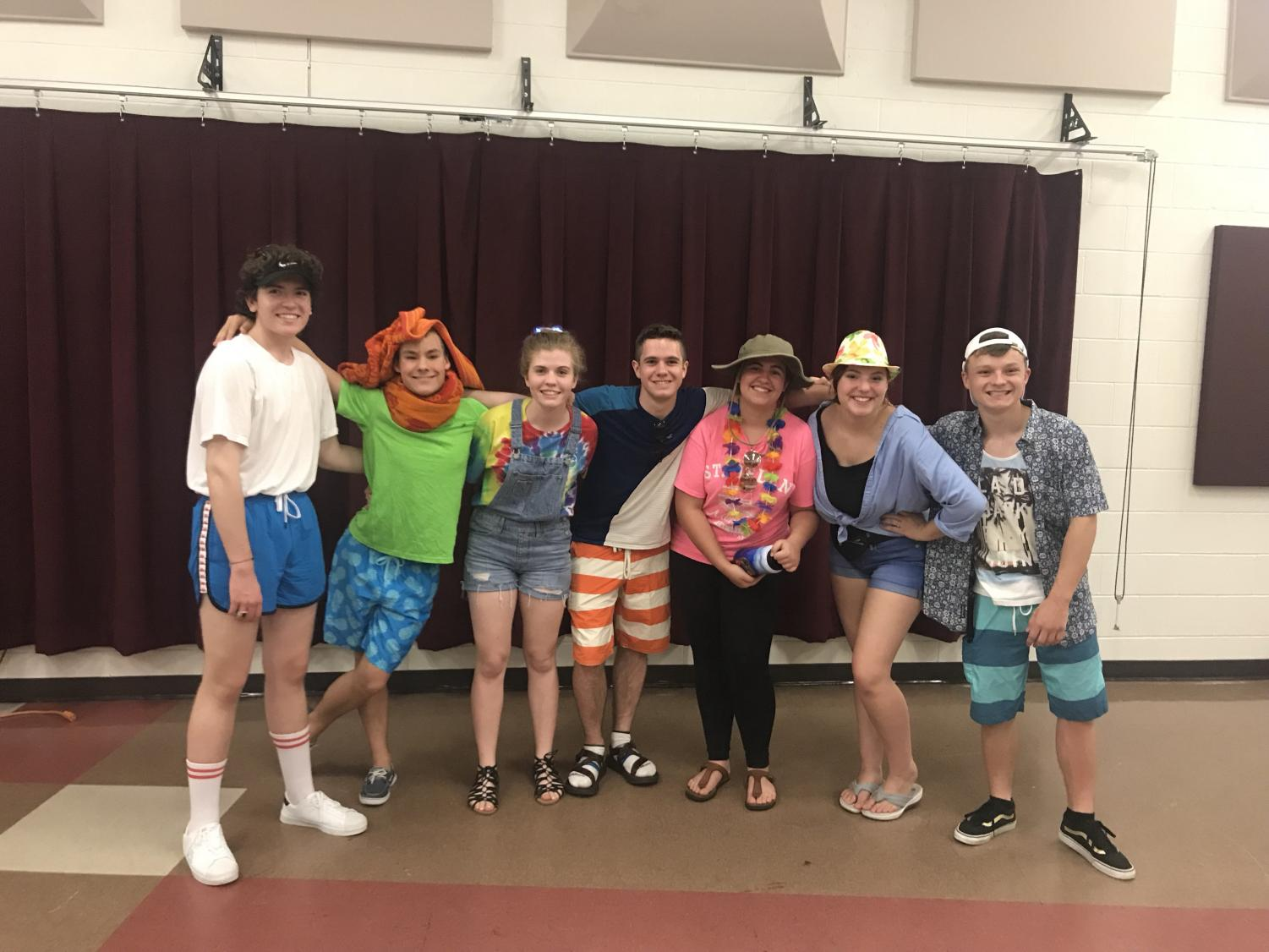 Pictured left to right, senior Isaac Reid, sophomore Charlie Marsh, junior Sydney Dudley, senior Elliot Hoinville, sophomore Maren Case, sophomore Ellie Mancina, and senior Ryan Daniel, all pose together, dressed in the theme of the night, summer wear. All photos by Kylie Clifton