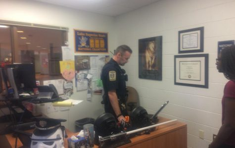 School Resource Officer Nate Slavin in his office command center, where he closely monitored the event and made the determination to initiate the precautionary lock-up for student safety.