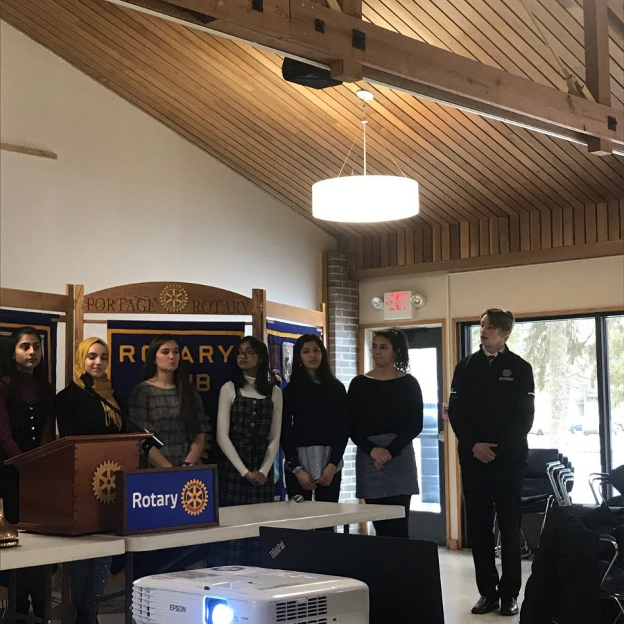 Interact Club members Snigda Narisetty, Rawan Alsaedi, Sara Gleason, Fahima Hossen, Zainab Fayyaz, Elena Aleman, and Peter Todd visit the Portage Rotary Club to showcase how their partnership has developed over the past 8 years. Photo by Mark Bielang.