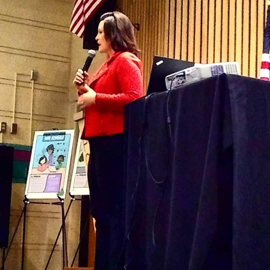Gretchen Whitmer speaks to citizens at Portage North Middle School about her upcoming budget plan.