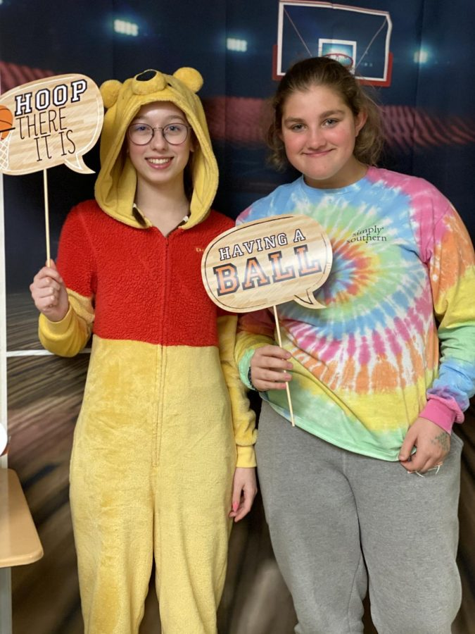 Sophomores Rachel Kelsey and Emma Partee try out the photo booth.