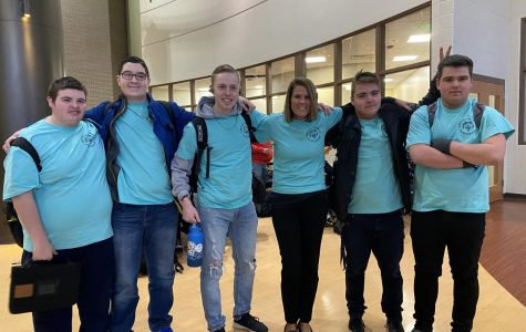 """Freshman Brandon Frick, sophomore Carter Belson, junior Max Zigterman, assistant principal Kelly Hinga, sophomore Ian Luczak, and freshman Xavier Luczak. """"I wanted to jump in the freezing cold water and it's for a good cause,"""