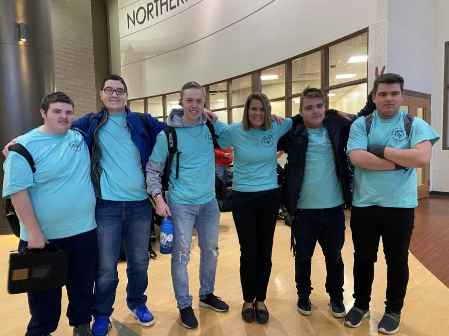 "Freshman Brandon Frick, sophomore Carter Belson, junior Max Zigterman, assistant principal Kelly Hinga, sophomore Ian Luczak, and freshman Xavier Luczak. ""I wanted to jump in the freezing cold water and it's for a good cause,"