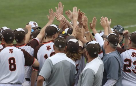 """Before every game, the team gets together and everyone high fives each other, which we call the """"five finger discount."""" This picture is from the state championship game, the last Huskie baseball game for both the 5 seniors and 12 juniors on the team."""
