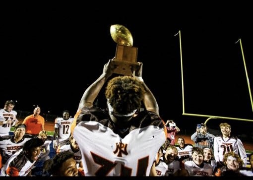 Anthony hoists the Kavanaugh trophy after PNs victory over PC in 2019.