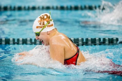 Baker swims in the 2019 State meet.