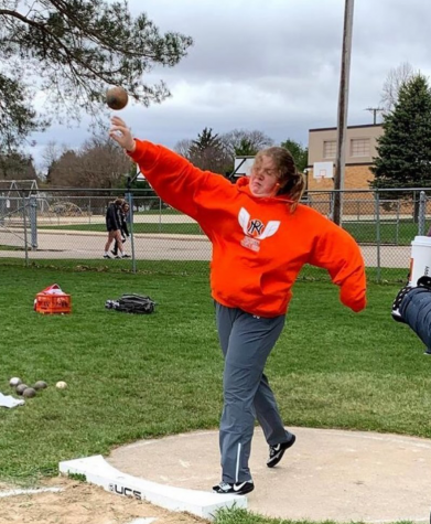 Sophomore Charlotte Wilson throws a shot-put at an outdoor meet. She looks up to other women in this male-dominated sport: The women throwing records are really trailblazers, she says. Photo courtesy of Charlotte Wilson.