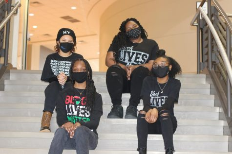 BHM leaders L to R: back row: Maya Daniels, Makayla Bolton, front row: Alanna Harris, Jamillah Clark wrap up filming the assembly on the stairs leading to the lower level commons.